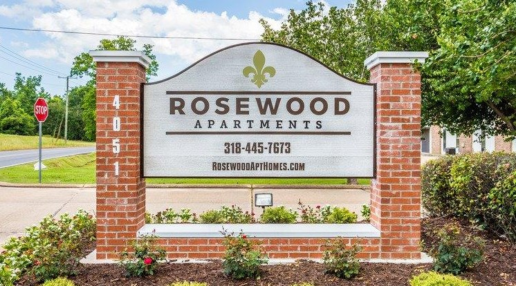 front entrance sign at Rosewood Apartments in Alexandria, LA.